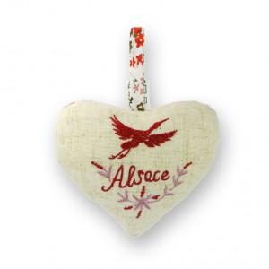 """Coeur à suspendre Cigogne rouge en """"vol"""", dos fleuri"""
